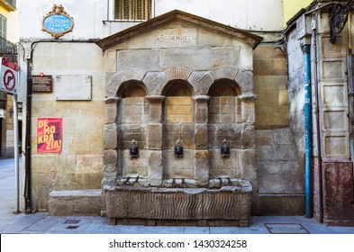 Bilbao, Biscay, Basque Country, Spain - February, 12th, 2019 : Neoclassical fountain at Calle del Perro street in the Siete Calles old town, the medieval neighbourhood of Bilbao.