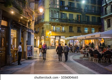 BILBAO, SPAIN - 14 FEBRUARY: Evening mood on the square in front of the Catholic Church Tribunal eclesiástico. 14 FEBRUARY 2018