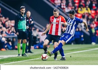 Bilbao, Spain. 27th April, 2019. Pais Vasco. San Mamés. Liga santander. Athletic Bilbao v D. Alavés: Oscar de Marcos tries to controll the ball against Carlos Vigaray (#2)