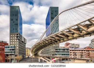BILBAO, SPAIN - April 07, 2016: Zubizuri Bridge made by Santiago Calatrava in Bilbao, Spain. It is a modern arch bridge that hangs over the river Nervin in Bilbao.