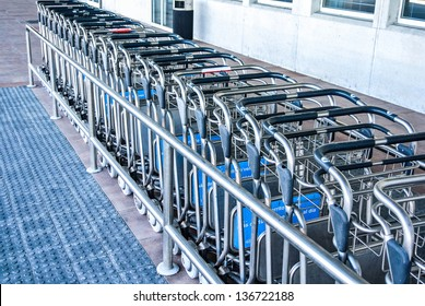 BILBAO, SPAIN - APRIL 13: Several carts for transporting luggage in the airport. The cost of using them in Spanish airports is 1 euro. April 13, 2013 in BIlbao, Basque Country, Spain