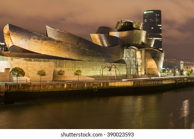 Bilbao, Spain - August 11, 2014: The Guggenheim Museum, designed by Frank Gehry and completed in 1997, and the Iberdrola Tower, designed by Cesar Pelli and completed in 2011, in Bilbao, Spain.
