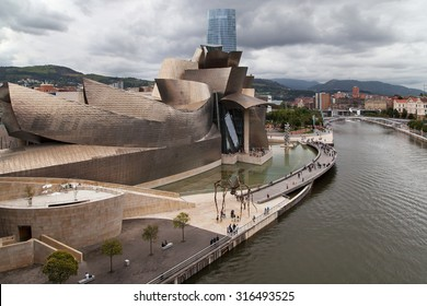 BILBAO, SPAIN - AUGUST 11: The Guggenheim Museum on August 11, 2014 in Bilbao, Spain. Designed by Frank Gehry in 1997 and built alongside the river Nervion, houses collections of contemporary art.