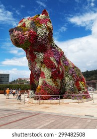 BILBAO, SPAIN - AUGUST 13: Puppy, sculpture designed by Jeff Koons in 1992, on August 13, 2014 in front of the Guggenheim museum of Bilbao, Spain.