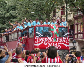 Bilbao, Spain - August 2015: Closeup front view of Athletic Club Bilbao players in their official bus and street crowded celebrating winning the Supercopa