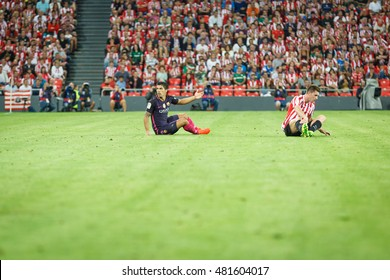 BILBAO, SPAIN - AUGUST 28: Luis Suarez, FC Barcelona player, and Aymeric Laporte, Bilbao player, in the match between Athletic Bilbao and FC Barcelona, celebrated on August 28, 2016 in Bilbao, Spain