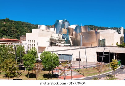 BILBAO, SPAIN - AUGUST 9: Exterior view of the Guggenheim Museum at sunset on Bilbao, Spain. 2013.This Museum is dedicated exhibition of modern art.