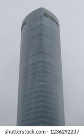 Bilbao, Spain - December 08, 2017: The modern Iberdrola Tower (Torre Iberdrola) skycraper in Bilbao, Basque Country, Spain, in a foggy cold winter day