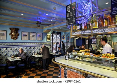 "BILBAO, SPAIN - December 16, 2015. In the Basque Country you will find the best Pintxo-?apas ?ars of Spain. One of them is the ""Cafe Bilbao"", in Plaza Nueva, Casco Viejo, the old part of Bilbao."
