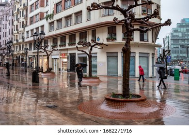 BILBAO, SPAIN - FEBRUARY 25  2020: Rainy day in the pedestrian zone.