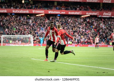 BILBAO, SPAIN - JANUARY 13, 2019: Iñaki Williams (L) and Iker Muniain (R), Athletic players, celebrate the goal during a Spanish League match between Athletic Club Bilbao and Sevilla FC