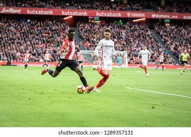 BILBAO, SPAIN - JANUARY 13, 2019: Iñaki Williams (L) and Sergi Gomez (R) dispute the ball during a Spanish League match between Athletic Club Bilbao and Sevilla FC at San Mames Stadium
