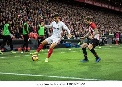 BILBAO, SPAIN - JANUARY 13, 2019: Andre Silva (L) and Iñigo Martinez (R) dispute the ball in the Spanish League match between Athletic Club Bilbao and Sevilla FC at San Mames Stadium