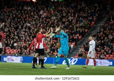 BILBAO, SPAIN - JANUARY 13, 2019: Yeray Alvarez (L) and Iago Herrerin (R) celebrate the victory after the Spanish League match between Athletic Club Bilbao and Sevilla FC at San Mames Stadium