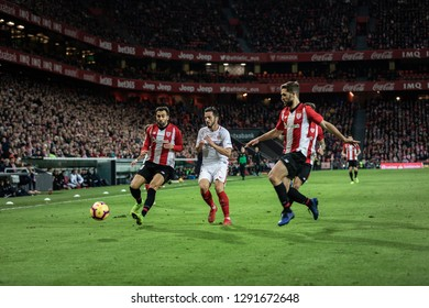 BILBAO, SPAIN - JANUARY 13, 2019: Pablo Sarabia (C), Mikel Balenziaga (L) and Iñigo Martinez (R) dispute the ball during a Spanish League match between Athletic Club Bilbao and Sevilla FC at San Mames