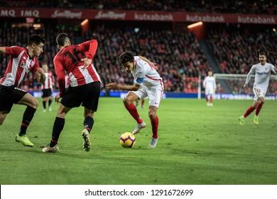 BILBAO, SPAIN - JANUARY 13, 2019: Jesus Navas (R) and Dani Garcia (L) dispute the bal during a Spanish League match between Athletic Club Bilbao and Sevilla FC at San Mames Stadium