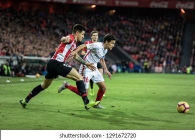 BILBAO, SPAIN - JANUARY 13, 2019: Jesus Navas (R) and Yuri Berchiche (L) dispute the ball during a Spanish League match between Athletic Club Bilbao and Sevilla FC at San Mames Stadium