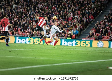 BILBAO, SPAIN - JANUARY 13, 2019: Ander Capa (L) and Andre Silva (R) dispute the ball during a Spanish League match between Athletic Club Bilbao and Sevilla FC at San Mames Stadium