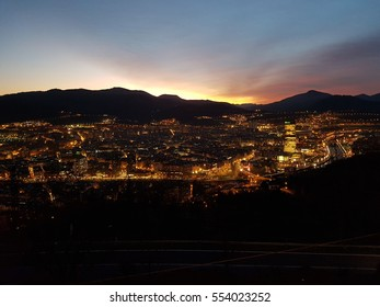 Bilbao, Spain - January 2017: Night cityscape at sunset from a surrounding mountain