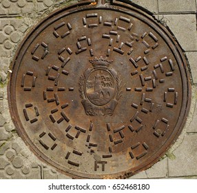 BILBAO, SPAIN -JULI, 10,2014:interesting design metal manhole cover  with  the emblem of the city