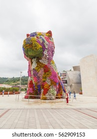 BILBAO, SPAIN - JULY 04: Puppy,  sculpture designed by Jeff Koons,   in front of the Guggenheim museum of Bilbao, Spain.