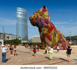 BILBAO, SPAIN - JULY 4, 2015: Puppy by Jeff Koons in front of  Guggenheim Museum in Bilbao. Spain