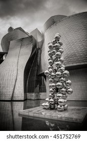"BILBAO, SPAIN â?? JUNE 18, 2016: Sculpture ""The Big Tree"" consisting of 80 stainless steel balls with reflections by Anish Kapoor in front of The Guggenheim Museum in Bilbao, Basque Country, Spain"
