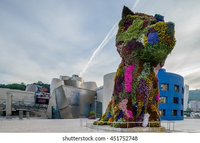 BILBAO, SPAIN - June 20: Puppy, sculpture designed by Jeff Koons in 1992, on June 20, 2016 in front of the Guggenheim museum of Bilbao, Spain.