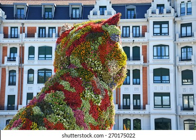 BILBAO, SPAIN - MARCH 10, 2015: The floral sculpture 'Puppy' - Standing in front of Bilbao's Guggenheim Museum at 43 feet tall, the flower-covered topiary is a symbol of Spain's fifth-largest city.