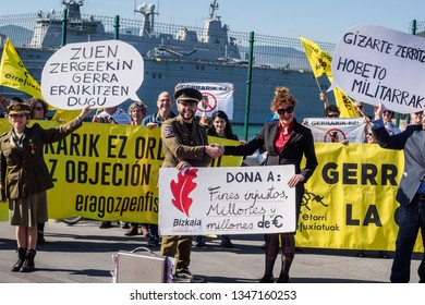 BILBAO, SPAIN - MARCH / 23/2019. People protesting the arrival of the aircraft carrier of the Spanish Navy Juan Carlos I in the port of Bilbao during open day to visit the ship.