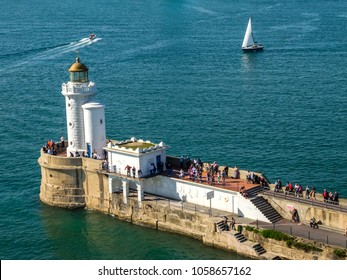 BILBAO, SPAIN - MARCH 28 2017: Lighthouse near new port at harbor Bilbao, people in hundreds came to welcomes passengers on cruise ship arrived at new port.