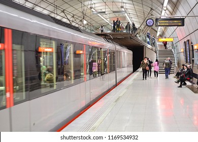 BILBAO, SPAIN - MAY 3, 2018 - Blurred CAF train departing one of the characteristic Bilbao metro station designed by Norman Foster