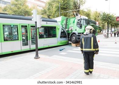 BILBAO, SPAIN - NOVEMBER 19: Fireman looks at the work of removing the tram, on November 19, 2015 in Bilbao, Spain