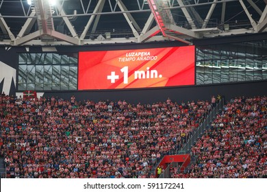 BILBAO, SPAIN - OCTOBER 16: Video scoreboard indicates one minute added, in the match between Athletic Bilbao and Real Sociedad, celebrated on October 16, 2016 in Bilbao, Spain