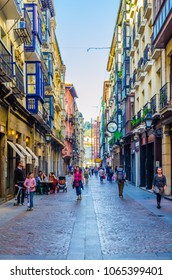BILBAO, SPAIN, OCTOBER 29,2014: People are strolling through a narrow street of the old town of Bilbao, Spain