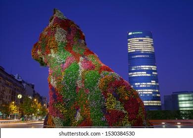 Bilbao, Spain, Sept. 14, 2019: Jeff Koons puppy at Guggenheim museum at night, Bilbao, Spain. Sept. 14, 2019 in Bilbao, Spain.
