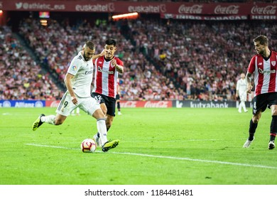 BILBAO, SPAIN - SEPTEMBER 15, 2018: Karim Benzema, Real Madrid player and Yuri Berchiche, Athletic Club Bilbao player in action during a Spanish League match between Athletic Bilbao and Real Madrid