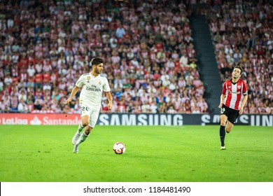 BILBAO, SPAIN - SEPTEMBER 15, 2018: Marco Asensio, Real Madrid player and Markel Susaeta, Athletic Club Bilbao player in action during a Spanish League match between Athletic Bilbao and Real Madrid