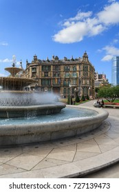 BILBAO, SPAIN - SEPTEMBER 19, 2015: Fountain at Moyua square and Chavarri Palace in Bilbao