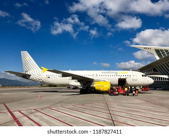 BILBAO, SPAIN - SEPTEMBER 25, 2018: A Vueling Airbus A320 jet passenger aircraft parked on stand at Bilbao International Airport in Bilbao, Spain.