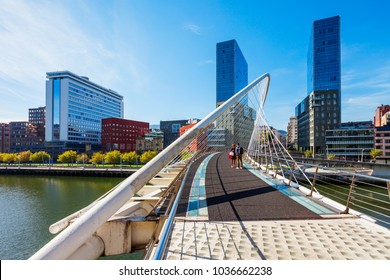 BILBAO, SPAIN - SEPTEMBER 28, 2017: Zubizuri bridge through Nervion River in the centre of Bilbao, Basque Country in northern Spain