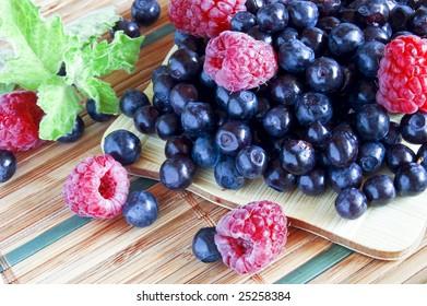 bilberrie and raspberries, summer fruits