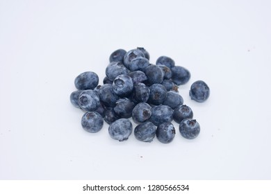 Bilberry Blue Berry Bilberries are a primarily Eurasian species of low growing shrubs in the genus Vaccinium bearing edible, dark blue berries.