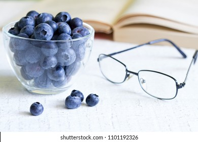 Bilberry cure for eyes concept with glasses