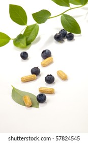 Bilberry extract pills and fresh berries and leaves best suited for alternative medicine ads