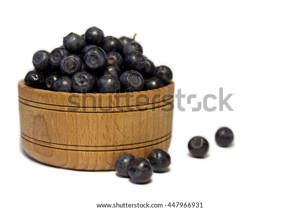 bilberry  in the wooden bowl isolated
