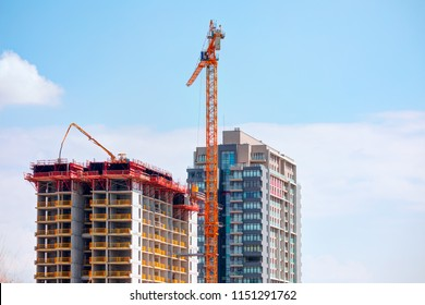 Bilding construction in the city - Crane and building under construction