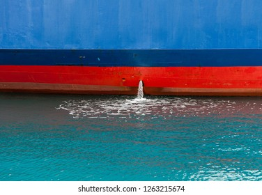 Bilge Pump.  Close-up of Bilge pump excreting water from Ship. The collected water must be pumped out to prevent the bilge from becoming too full and threatening to sink the ship.Stock Image.