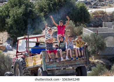 Bilin, Palestine, December 3, 2010: Palestinian boys are sitting on the back of a truck in the village of Bilin, north of Ramallah.