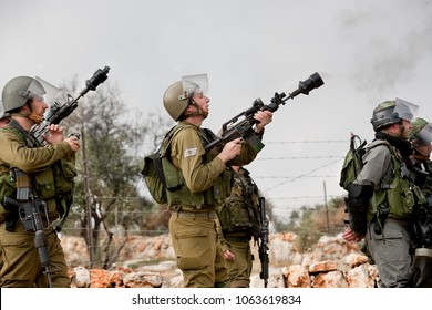Bilin, Palestine, December 31, 2010: Israel Defence Force is shooting tear gas during weekly demonstrations against Palestinian land confiscation and building Jewish settlement in Bilin.
